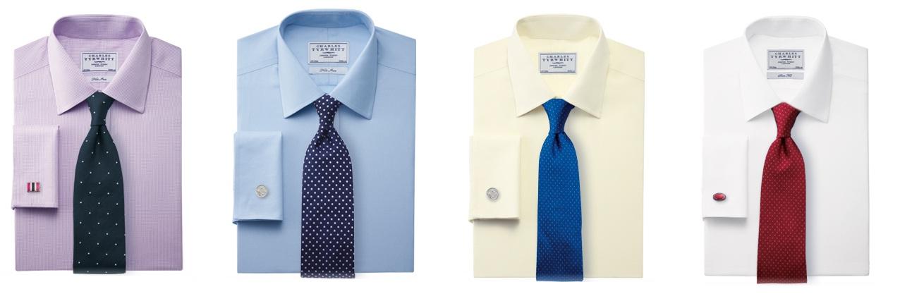 Является синий однотонный костюм, белая рубашка и галстук в крапинку